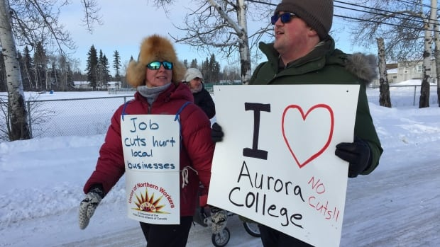 Protesters gathered in Fort Smith, N.W.T to protest proposed cuts at Aurora College that would end the education and social work program at the college.