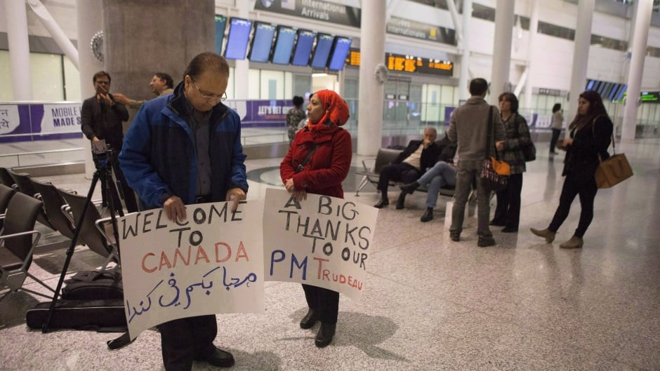 Well-wishers gather in the hope of greeting Syrian refugees arriving on the first government arranged flight at Toronto's Pearson Airport, on Dec. 10, 2015.