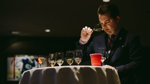 Shane Taylor takes a sniff during the blind tasting portion of the 2017 Best Sommelier of B.C. competition.