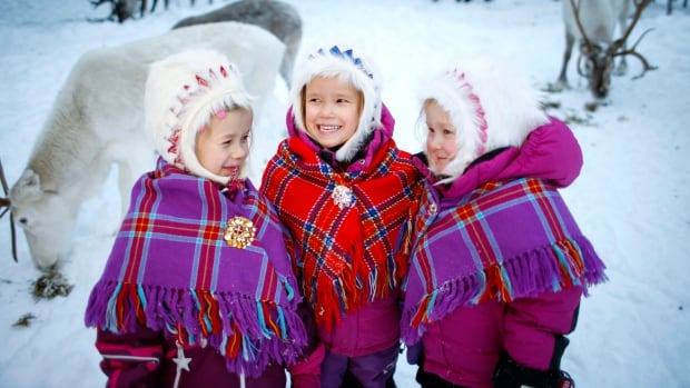 Sami children Karen Seline Eira, Inga Helene Anti Persen and Leah Christine Utsi at the reindeer kindergarten in Karasjok, Norway. The Indigenous people of Europe's Arctic region are celebrating the centenary of their national day, Monday, Feb. 6, 2017.