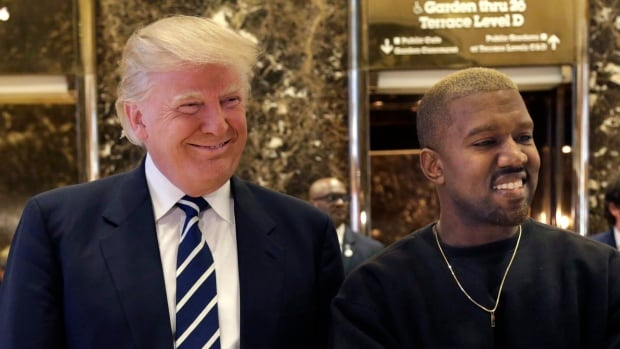 President Donald Trump and Kanye West, seen here in December 2016, pose for a picture in the lobby of Trump Tower in New York after their meeting.