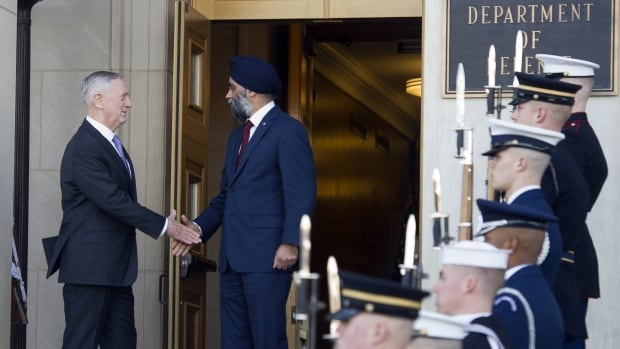 U.S. Defense Secretary Jim Mattis, left, and Canadian Defense Minister Harjit Sajjan shake hands at the Pentagon Monday before talking NATO and defence spending.