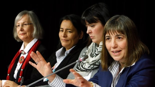 Marion Buller, left, Chief Commissioner of the National Inquiry into Missing and Murdered Indigenous Women and Girls, and commissioners Michele Audette and Qajaq Robinson, and Susan Vella, lead legal counsel for the commission, held the first MMIW inquiry news conference in Ottawa Tuesday, six months after the inquiry's launch.