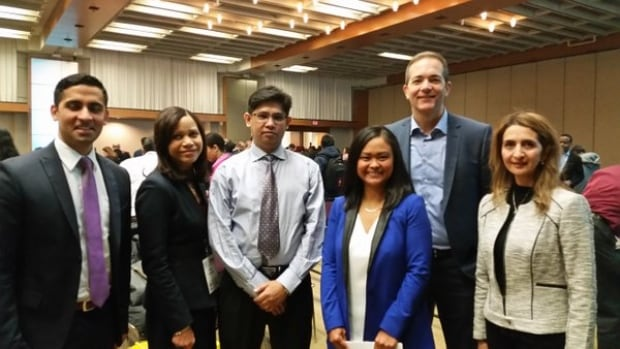 IEP President Silma Roddau, along with IEP attendees, and CBC Toronto's Marivel Taruc and Mike Wise.