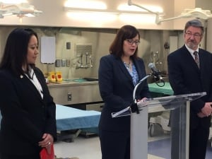Justice Minister Kathleen Ganley, (centre) announces new funding for medical examiner's office