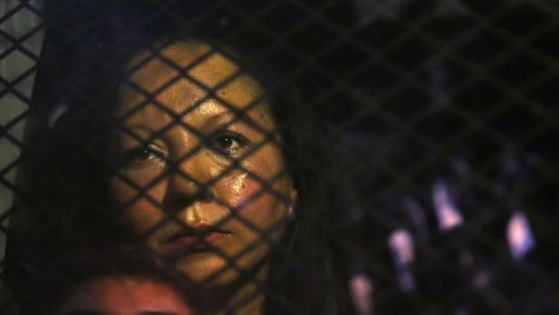 Guadalupe Garcia de Rayos is seen in a van that was stopped by protesters outside the Immigration and Customs Enforcement facility in Phoenix on Wednesday.