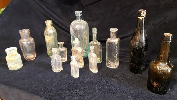 These are just a few of bottles that Nancy Allen found buried in her yard.  The brown bottle on the far right has been positively identified as a malt/beer bottle that was used from the 1880s into the 1920s.