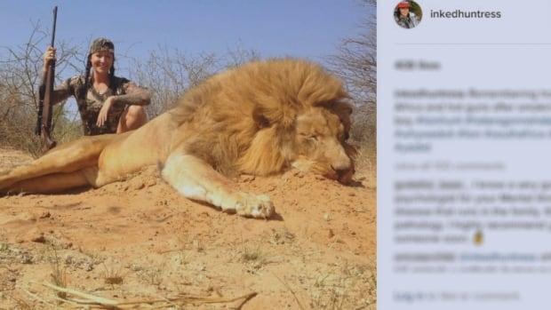 Jacine Jadresko poses with a lion