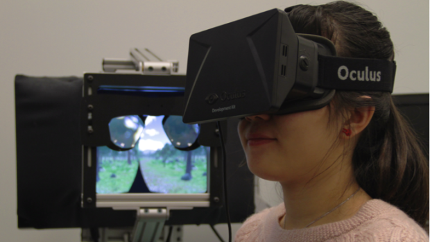 A chronic pain patient at the pain studies lab at Simon Fraser University in Burnaby, B.C., wears a Oculus Rift head-mounted display during a virtual meditative walk.