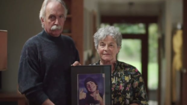 Carl Miller and Leslie McBain hold a photo of their son, Jordan, who died of an oxycodone overdose in 2014. For the past two years, McBain has been telling B.C. students how to protect themselves from the risks associated with opioids.