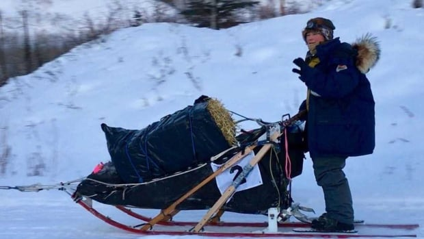 Yuka Honda, seen outside Pelly Crossing, dropped out of this year's Yukon Quest after her sled dog Firefly died.