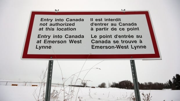 A sign near Emerson, Man.  where refugees have been crossing the closed border port into Canada.