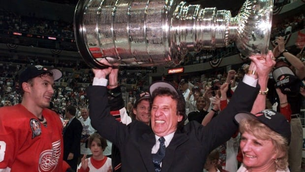 Mike Ilitch, centre, hoists the Stanley Cup after his Red Wings won the championship in 1998. He died Friday at age 87.