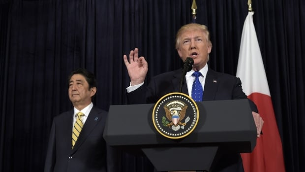 U.S. President Donald Trump speaks as Japanese Prime Minister Shinzo Abe listens as they both made statements about North Korea's recent missile launch at Mar-a-Lago in Palm Beach, Fla., on Saturday.