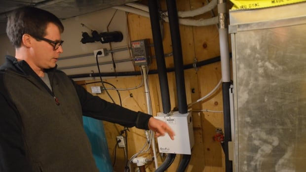 Jason Neva, who lives in the Whitefish area of Greater Sudbury, demonstrates the geothermal system he put in his home at a cost of $23,000.
