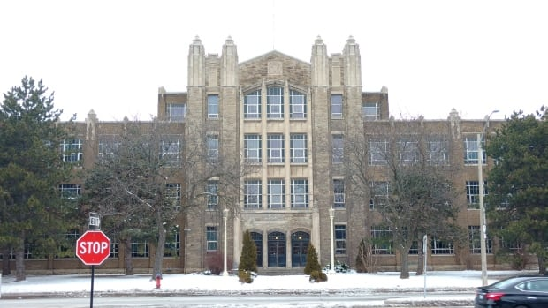 Police arrested two men around 3:30 a.m. Tuesday after they allegedly broke in to Westdale Secondary School, seen here last winter, overnight.