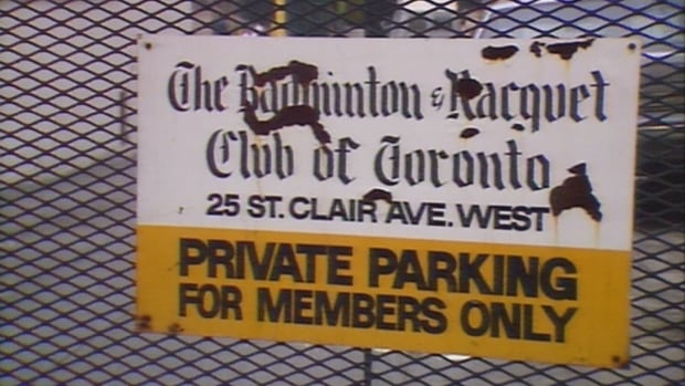 A sign outside the Badminton and Racquet Club in 1987. Controversy surrounding the club's 'unwritten policy' upset members of the community.