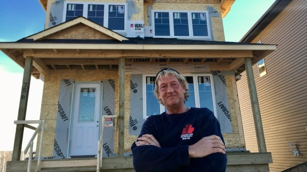 Steven Menard is proud of the progress he's made rebuilding his home in the Fort McMurray subdivision of Abasand. His home was destroyed in May's wildfire.