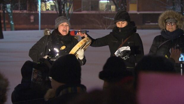 A woman sings at a demonstration at Place Émilie Gamelin Wednesday night against what they call rape culture and the 'systemic issues' that prevent women from speaking out when they've been sexually assaulted.