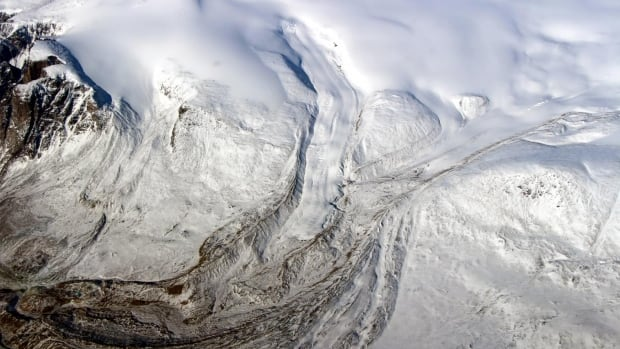 Canada's glaciers and ice caps are now a major contributor to sea level change, a new UCI study shows. Ten times more ice is melting annually due to warmer temperatures. Seen here is the edge of the Barnes Ice Cap in May 2015.
