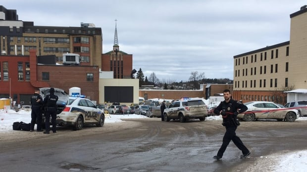 Saguenay police officers are searching the Chicoutimi hospital and surrounding neighbourhood after security guards reported seeing a man with a knife inside the building.