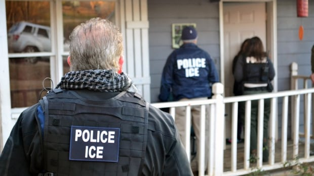 U.S. Immigration and Customs Enforcement (ICE) officers conduct a targeted enforcement operation in Atlanta, on Feb. 9.