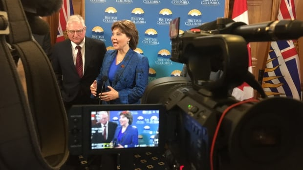 David Emerson (left) and Christy Clark participate in a news conference following a special cabinet meeting on Thursday.