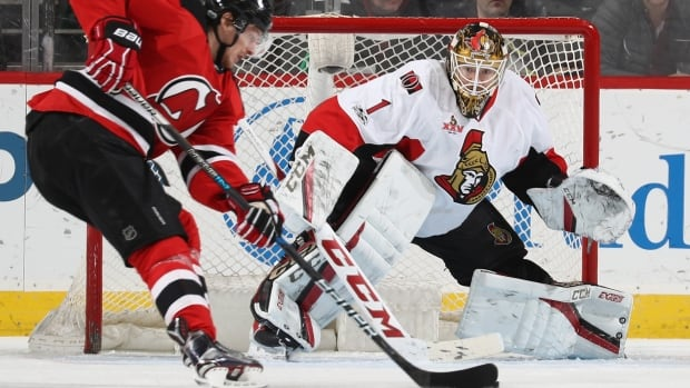 Ottawa goalie Mike Condon stops New Jersey's Sergey Kalinen Thursday on his way to his fifth shutout of the season.