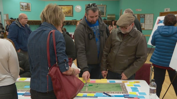 People examine a map of the Lauderdale off-leash dog park during the city's open house Thursday.