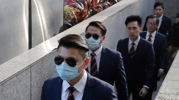 In this Feb. 14, 2017 file photo, five of the seven Hong Kong police officers arrive at the District Court in Hong Kong as they were charged with assaulting a pro-democracy activist in an incident on Oct. 15 2014. The seven were sentenced Friday to two years in prison for assaulting a pro-democracy activist at the height of 2014 protests.