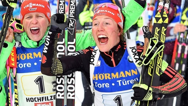 Germany's Laura Dahlmeier, right, celebrates her team's win in the women's 4x6 km relay with Maren Hammerschmid on Friday in Hochfilzen, Austria to become the first biathlete to medal in 10 consecutive world championship races.