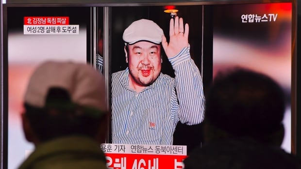 People watch a television showing news reports of Kim Jong-nam in Seoul on Tuesday. South Korea has accused its enemies in North Korea of dispatching a hit squad to kill Kim Jong-nam at the airport in Kuala Lumpur, saying two female assassins poisoned him and then fled in a taxi.