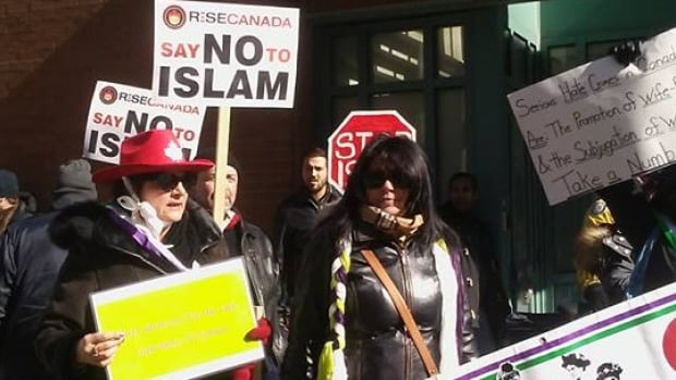 More than a dozen people gathered outside a mosque in the heart of downtown Toronto with loudspeakers and banners in hand, shouting slogans about banning Islam as Muslims gathered to pray inside.
