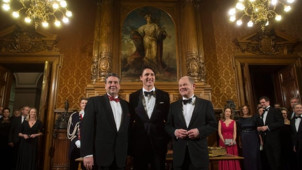 Canadian Prime Minister Justin Trudeau, centre, Hamburg Mayor Olaf Scholz, right, and German Foreign Minister Sigmar Gabriel, left, pose for photographers at city hall in Hamburg, Germany, on Friday. Trudeau later gave a speech talking about warding off populist anger by addressing middle-class anxiety.