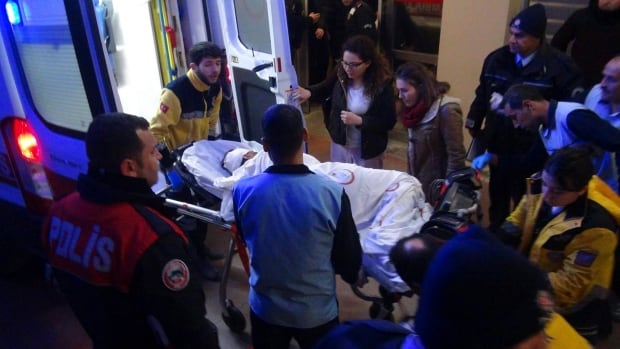Paramedics carry a victim of a car bomb attack at a hospital in Viransehir, Turkey, late Friday.