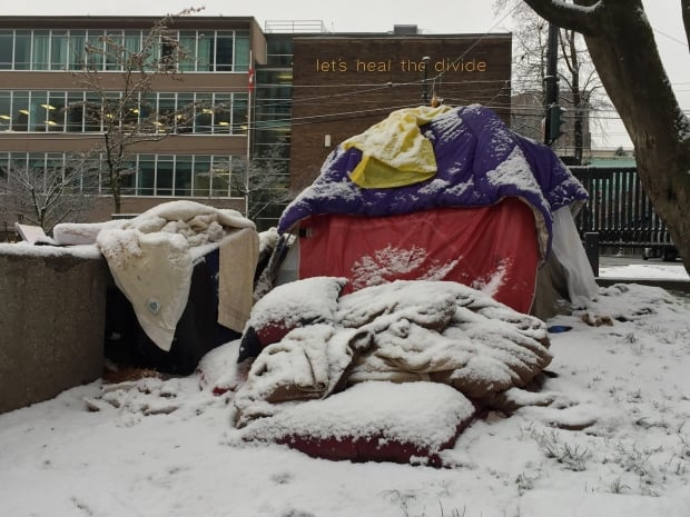 Let's heal the divide - homeless camper in snow Vancouver