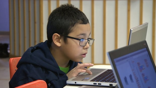 A child soaks up the learning at the Pinnguaq coding workshop in Iqaluit this week.