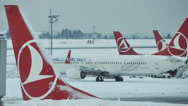 Turkish Airlines planes in this photo are stationed at Ataturk International Airport in Istanbul on Tuesday, Jan. 10, 2017. A Turkish Airlines plane in Istanbul was evacuated Saturday after a suspicious note was discovered in one of its bathrooms. The words 'BOMB TO TORONTO' were found on the bathroom's wall