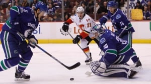 Miller outshines Flames while Tanev seals deal for Canucks in OT