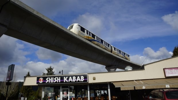 The new Evergreen Line SkyTrain makes its way over North Road and Cottonwood Avenue.