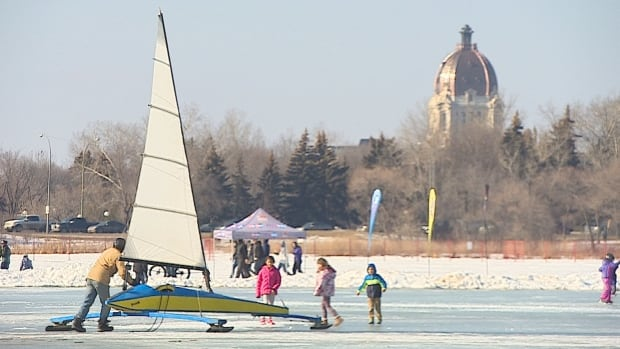 Children watch as an ice yacht is guided and glided across the frozen Wascana Lake at last year's Waskimo Winter Festival.