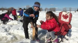 Syrian refugees learn to ice fish