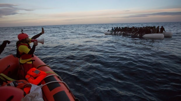 Migrants and refugees are shown about 30 kilometres north of Sabratha Libya on Feb. 3. Migrant deaths have risen to record levels along the Libya Italy smuggling route across the Mediterranean with dozens of deaths reported early Tuesday