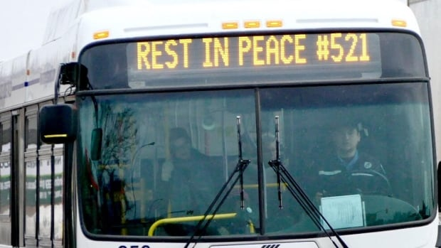 Winnipeg Transit buses displayed rest in peace signs a year ago in honour of the funeral for slain operator Irvine Jubal Fraser, whose badge number was 521.