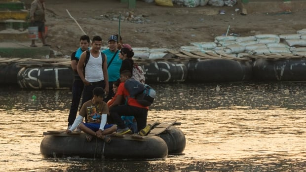 Migrants cross by raft from Tecun Uman, Guatemala, to Tapachula, Mexico. The migrant route through South and Central America, Mexico and the U.S. has become a popular one from asylum seekers coming from Africa and Asia and destined for Canada.