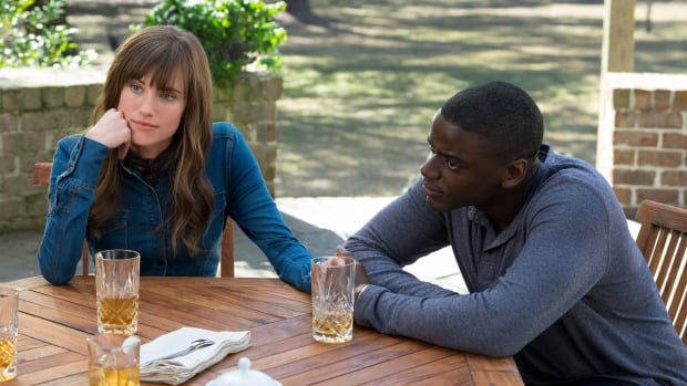Chris, played by Daniel Kaluuya, meets the parents of girlfriend Rose, played by Allison Williams, in Get Out.