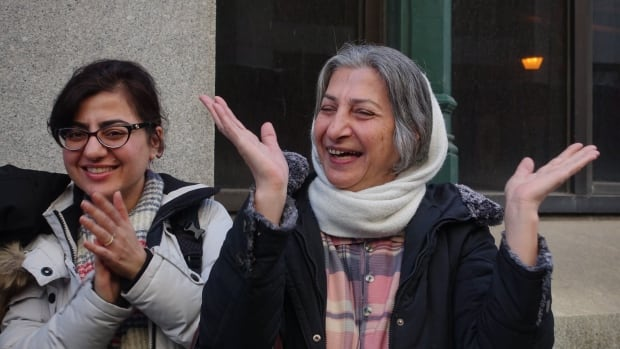 Sahar Bahrami and her mother, Roghayeh Azizi Mirmahaleh, outside an Immigration, Refugees and Citizenship Canada office in downtown Montreal. Azizi Mirmahaleh was to be deported to Iran next week, but was granted a temporary residency permit Thursday morning.
