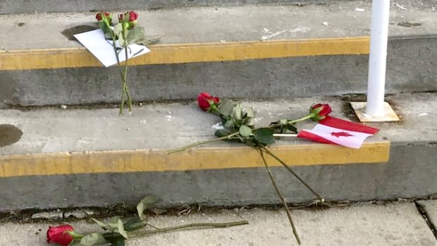 Flowers were left on the Red Deer Islamic Center steps, replacing a hateful message left scrawled in the snow on Sunday.
