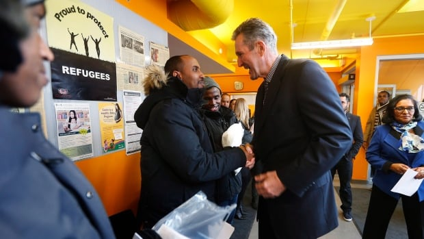 Manitoba Premier Brian Pallister meets with refugee claimants at Welcome Place, a refugee support organization in Winnipeg, to announce emergency support for rasylum seekers crossing the Manitoba border from the United States.