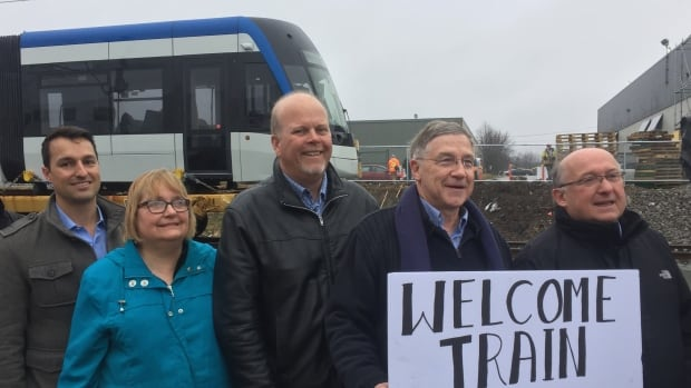 Local officials greeted the first LRT vehicle when it arrived in February. Those attending the welcoming included Mark MacGregor, Bombardier project manager, stands alongside Counc. Jane Mitchell, Councl. Sean Strickland, Counc. Ken Seiling and Coun. Tom Galloway.